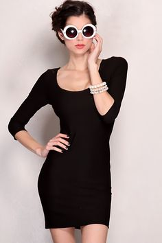 When selecting an ensemble for an exciting night out, youre only concerned with one person's thrills - your own! Dress to impress your sassy self in this sexy black dress. This dress features quarter sleeves, scoop neck and tight fitted to show off those sexy curves you have. Pair this dress with Mary Jane pumps, faux pearls jewels and let your hair lose. This will have you looking stunning. Model is wearing a small. 64% Nylon 32% Nylon 4% Spandex