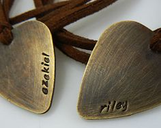 Guitar pick necklace hand stamped Plectrum never give up