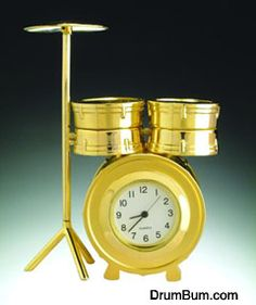Brass Drumset Clock  - an elegant and unique gift idea for the drummer in your life. Made of solid brass, this clock is sturdy and practical. Whether an amateur or pro drummer, this would make a nice gift item.