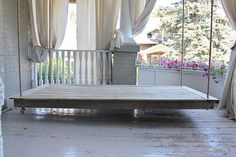 Hanging porch bed!  Add a mattress and pillows and relax!