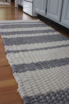 Woven kitchen runner made with piping cord and a homemade loom from an old door...love this!!!