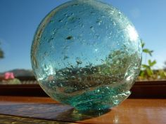 Hand blown Japanese glass fishing float...full of bubbles and imperfections in the true spirit of wabi sabi.