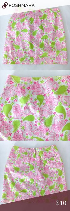 """Lilly Pulitzer poker-playing cats paisley skirt Pink cats playing cards, counting chips, and sipping cocktails, with green paisley pattern  Rear zip and hook-and-eye closure Gently preloved condition. Three tiny dots near hem, reflected in price. Not very noticeable with busy pattern. Please see last photo.  100% cotton (Fully lined. lining = 65% polyester, 35% cotton) Measurements are approximate, taken when garment is lying flat:  Waist = 13""""  Hips = 18"""" Length = 16.5"""" Lilly Pulitzer…"""