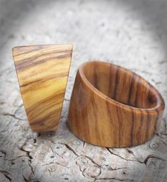 The Tribal Wood ring is a stunning addition to our range of contemporary wooden jewellery . Made from striking Olive wood this wooden ring with it's stylish design measures 16 mm at its widest point tapering to 7mm giving a surprisingly comfortable fit. Wonderfully tactile and smooth and the perfect way to experience the warmth of wooden rings. Each Tribal wooden ring is individually handcrafted so grain and colour may vary slightly, however only the most striking Olive wood will be used…