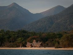 """Greystoke Mahale, a lodge in the east of the country known for its local chimpanzee populations, made the top of two of our specialists' lists. """"It's got the magic and remoteness of Lake Tanganyika—you reach it from the airstrip by dhow (a traditional sailboat used on the East African coast). But there's also great local staff, and the funky stylish design,"""" says Briggs. The six bandas, built of wood from old dhows, are all at the lake's edge"""