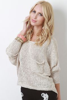 Sparkle up your style with the Twinkling Eyes Top! This top features loose woven knit with sequin accent throughout, round neckline, long dolman sleeves, left breast pocket, slight high-low hem, and finished with stitching detail.