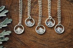 Woman/'s mountain scene charm pendant  in sterling silver and bronze and accented with a bronze star on an 18 sterling silver cable chain.