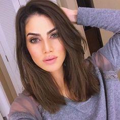 medium length hair and side swept bangs