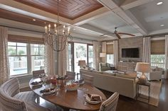 coffered ceiling taken from kitchen to sitting area, spaces are divided by differences in materials used in ceiling