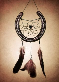 DIY Dream Catcher. Make it yourself with embroidery floss, feathers, sea glass and a horse shoe.