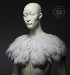 Spectacular white feather capelet that will make any outfit take to the sky, especially your perfect wedding attire.  It has lots of natural color goose feathers, carefully layered and securely sewn on, because durability is just as important as looks. The cape is finished with beautiful vintage type lace in the neckline.  The feather capelet closes in the front with narrow satin ribbons. The feather cape is made to order: I will make and send your unique item within a week after the order…