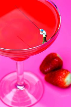 Fishing On A Red Cocktail Drink Little People On Food Photograph by Paul Ge - Fishing On A Red Cocktail Drink Little People On Food Fine Art Prints and Posters for Sale