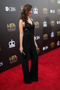 "Emily Ratajkowski rose to fame from Robin Thicke's controversial ""Blurred Lines"" music video, but it was her signature red carpet style that turned our heads."