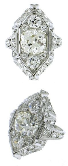 Art Deco near 5ct Diamond Platinum Ring, This stunning Art Deco dimensional ring features almost 5 carats of old mine and old European cut diamonds. USA Art Deco.