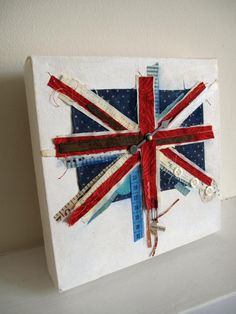 While it isn't really a piece of public art it has an interesting concept, making use of common materials to create a collage sculpture, we could possibly take a similar approach with our memorial piece rather than using more traditional means. Union Jack Decor, You Don't Know Jack, Union Flags, Travel Party, Home And Deco, Altered Art, Fiber Art, Fabric Crafts, Canvas Art