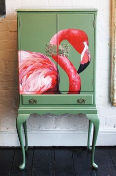 A classic example of the designs at Baroque&RollThis piece has been transformed from a classic piece of French furniture into a work of art. The moss green background offsets the pink flamingo beautifully. The interior of the piece is in a cerise pink. Decoupage Furniture, Hand Painted Furniture, Funky Furniture, French Furniture, Paint Furniture, Repurposed Furniture, Furniture Projects, Furniture Makeover, Furniture Layout