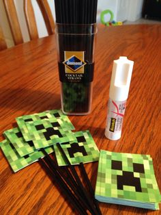 """DIY Minecraft cupcake toppers: black cocktail staws, 2""""square creepers printed from internet onto paper and cut out(photoshop), glue sick"""