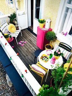 making the most of a small space. colorful apartment patio.