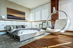 Modern Master Bedroom with Paint, Hardwood floors, West Elm Watercolor Solid Rug, Wall sconce, Molteni & C Clip Bed