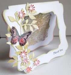 For this next one I used one of Kanbans aperture cards and butterfly background stamps. I stamped the background in embossing ink and clear embossed it, then I swiped the panel with various colour distress inks, before wiping with a tissue. The butterfly on the front of the card was also coloured with distress inks. Punched flowers and a Sissix leaf spray finished it off......