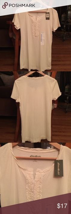 💞 Eddie Bauer Ruffle Front Top Shirt 💞 NWT, never worn Eddie Bauer short sleeve, ruffle front top shirt is 100% soft Cotton.  Could be worn as a layering piece for semi dress or worn casual as a tee alternative.  Smoke-free, pet-free home. Eddie Bauer Tops Tees - Short Sleeve
