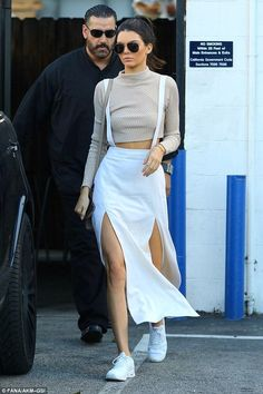 Kendall Jenner wearing Celine Nano Bag, Nike Air Max Thea Running Sneakers, Saint Laurent Classic 11 Aviator Sunglasses, Cartier Juste Un Clou Bracelet, Ullu Iphone Premium Leather Snap-on Case in Cowlick and Acne Studios Top in Light Beige