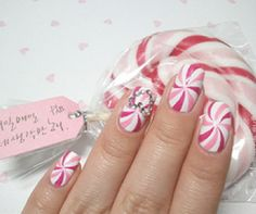 To achieve this look, apply white polish and allow it to dry completely. Then using a very steady hand and two different shades of pink polish pens, carefully draw on the swirls.