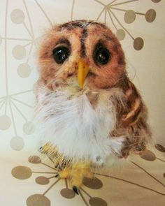 Collette has real feathersneedle felted in. She started out with the idea that she was to be an adult owl. But she cried out...