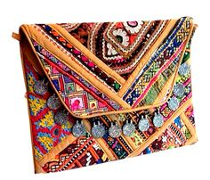 Gujarati Embroidery Banjara handbag and purses with tassels for ladies. Indian traditional and colorful designs ideal for this Christmas gifts from Kirti Textile