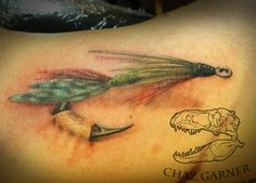 Fly fishing lure realism tattoo. Artist - Chaz Garner