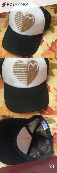 Gold Motocross Hat Gold glitter heart Motocross Hat. Still in excellent condition. Minor marks on the Hat, can most likely be cleaned up. Snap back trucker style. Brand is Motohed.  • No Trades • Price is firm unless bundled • 15% off of BUNDLES of 3 or more • Fox Accessories Hats