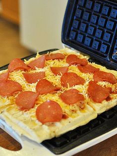 Make a pizza in your waffle iron!  http://greatideas.people.com/2014/03/25/waffle-maker-recipes-burger-cinnamon-rolls-cookies/
