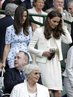 Kate at Wimbledon recycling her Joseph dress, Nessie Tweed Jacket and DVF clutch. Oh, and Pippa is there too.