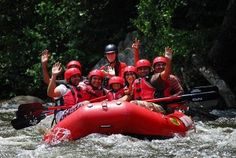A happy family experiencing the best white water rafting in Gatlinburg TN.
