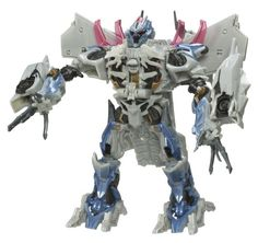 Megatron is a towering, bulky, dinosaur-footed monstrosity with a varied color scheme noticeably different than that of the movie version. Transformers Collection, Transformers Movie, Color Schemes, Action Figures, Lion Sculpture, Statue, Movies, Jet, Comic Con
