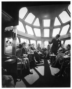 """Interior view of the Milwaukee Road's observation parlor car with sky-top lounge having a 90% transparent area dome that forms an aero-dynamic terminating shape for the end of the train. This scene is aboard the """"Afternoon Hiawatha"""", train No. 2 southbound, enroute from Minneapolis to Chicago. 1958."""