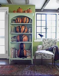 Pumpkins in a bookcase.
