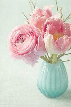 We love this sweet pink centerpiece with tulips and ranunculus. @weddingwire