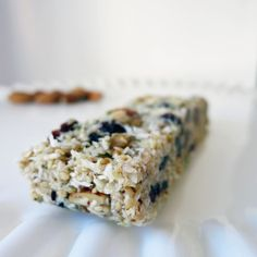 A delicious homemade granola bar recipe that uses no grains.mainly just nuts fruit and coconut! Great if you want to avoid oats or just want to pack more natural protein into your snacks. Add this one to your snack ideas file. Plus it's paleo! Paleo Recipes, Whole Food Recipes, Snack Recipes, Dessert Recipes, Desserts, Bar Recipes, Paleo Granola Bars, Muesli Bars, Paleo Nuts