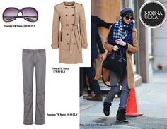 Anne Hathaway w casualowej stylizacji - podoba się wam? Ciemne, duże okulary, kamelowy płaszcz i proste szare spodnie typu miejskiego, a wszystko to do kupienia w sklepach TK Maxx!