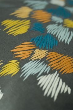Close-up of ZEBRAG CUSHION hand embroidered by KISANY Living Linens for OTAGO design using exclusive Libeco Linen.