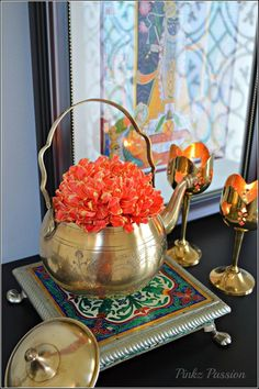 Brass collectibles, brass kettle, flowers housed in kettles, brass wares, Indian décor, Indian home decor