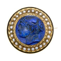 Such a noble profile! Victorian carved lapis cameo pin with seed pearl frame. Circa 1890, from Doyle & Doyle.