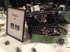 Perfect centerpieces for a journalist's wedding. Newspaper origami flowers and things like typewriters, fedoras, old phones & cameras.