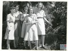 American Red Cross women in their uniforms on Tinian.  Gift of David Lawrence, from the collection of the National WWII Museum