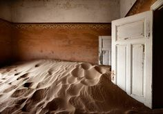 The 'Indoor Desert' series. Ghost House of Kolmanskop (Namibia; Located near a diamond mine and within the restricted area of Sperrgebiet, Kolmanskop was a small but rich mining village in southern Namibia, founded by a group of Germans once diamonds were first discovered in the area in 1908) by Álvaro Sánchez-Montañés (b1973 Madrid, Spain) http://www.alvarosh.es/en/bio