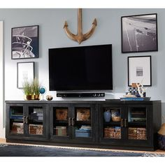 Pottery Barn Reynolds Modular Home Office Long Low Media Stand: 3... ($2,314) ❤ liked on Polyvore featuring home, furniture, storage & shelves, entertainment units, black media stand, pottery barn, low media cabinet, pottery barn tv stand and audio video stand