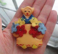 Martha Sleeper Early Bakelite Dutch Girl Pin w Applied Wool Flowers