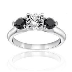 Reis-Nichols Jewelers : Three Stone Black And White Diamond Engagement Ring : 18K white gold with 3/4 ct round center diamond