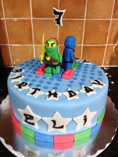 Ube flavor chiffon cake with ube buttercream frosting covered with MMF - Lego Ninjago cake for Eli